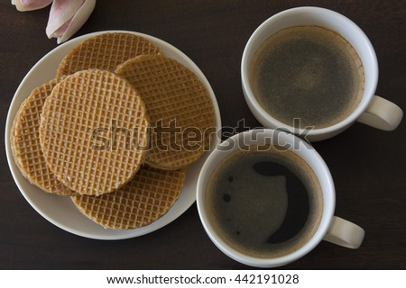Caramel Stroopwafels and Black Coffee - stock photo