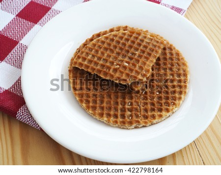 Caramel waffle on dish, served for breakfast, top view.