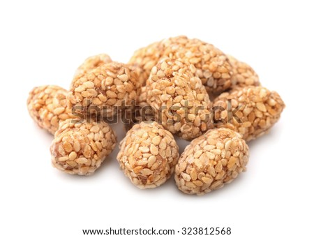 Caramelised peanuts and sesame balls isolated on white