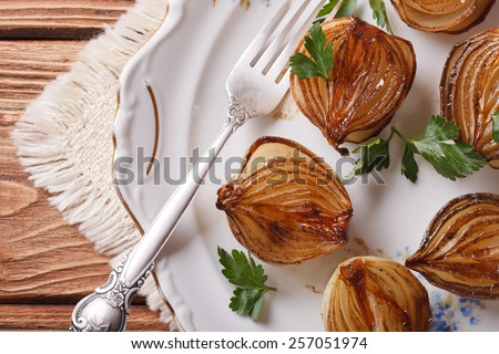 caramelized onions in balsamic vinegar on a white plate closeup. horizontal view from above - stock photo