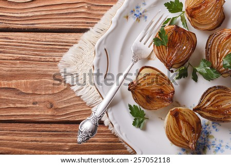 caramelized onions in balsamic vinegar on a white plate. horizontal view from above - stock photo