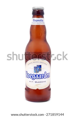 CARANSEBES, ROMANIA - DECEMBER 15, 2011: Hoegaarden beer bottle on white, Hoegaarden Brewery is a brewery in Hoegaarden, Belgium, and the producer of a well known wheat beer. - stock photo