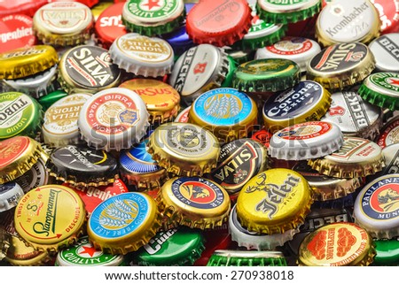 CARANSEBES, ROMANIA - JULY 6, 2014: Background of beer bottle caps, a mix of various european brands. - stock photo