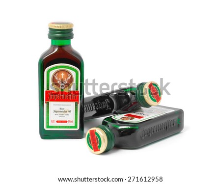 CARANSEBES, ROMANIA - JULY 6, 2011: 20 ml Jagermeister bottles isolated on white, German digestive drink made with 56 herbs and spices at a strength of 35% alcohol. - stock photo