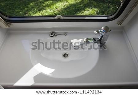 caravan interior travel trailer mobile home bathroom sink - stock photo
