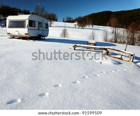 Caravan on a snowy mountain - stock photo