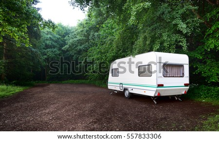 Caravan Trailer And A Car On Forest Road Summer Day