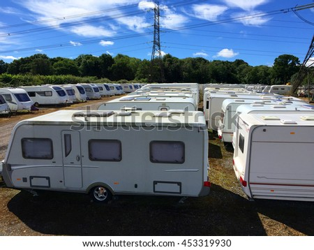 Caravans stored in rows on a sunny day. - stock photo