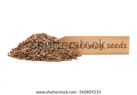Caraway seeds on plate - stock photo