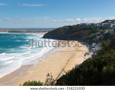 Carbis Bay Cornwall England near St Ives and on the South West Coast Path with a sandy beach on a beautiful blue sky sunny day  - stock photo