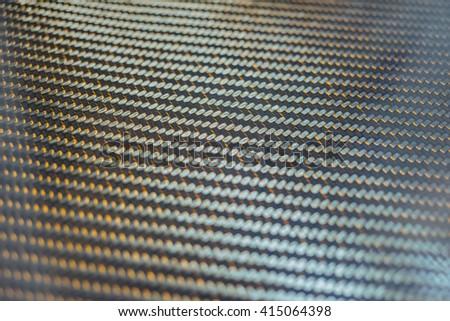 Carbon fiber glossy texture. Shallow focus.  - stock photo