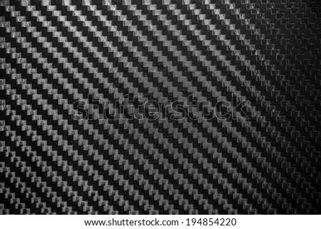 Carbon fiber texture background. para-aramid synthetic fiber. - stock photo
