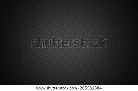Carbon fibre texture background image. Shadow and vignette effect. - stock photo