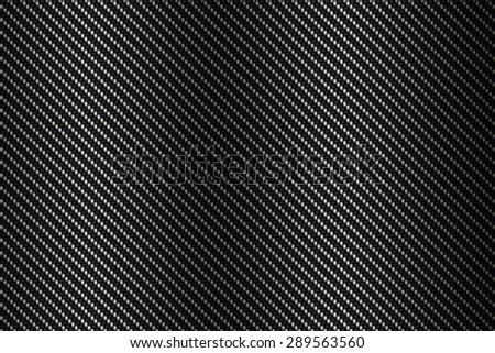 carbon kevlar texture background with black - stock photo