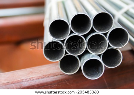 Carbon Steel Pipe and Structure Steel in Construction Site - stock photo