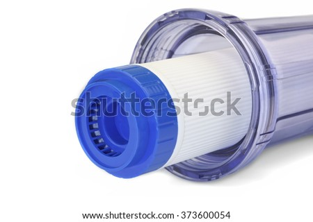 Carbon Water Filter Cartridge In Transparent Plastic Container Isolated On White Background, Close Up, Horizontal Image, Studio Shot - stock photo