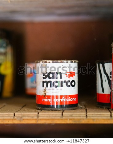 CARBONARA DI PO, ITALY - APRIL 19, 2016: Used dirty San Marco paint container on a dusty shelf
