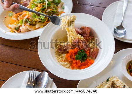 carbonara with ham pasta internal food in white bowl in resterant