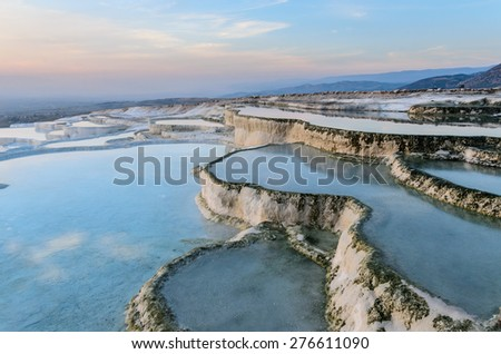 Carbonate travertines the natural pools during sunset, Pamukkale, Turkey - stock photo
