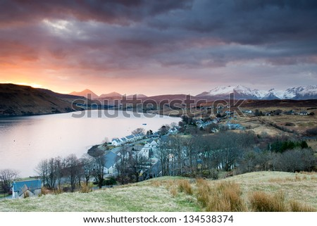 Carbost, Loch Harport and the Black Cuillins range at sunrise ,Scotland - stock photo