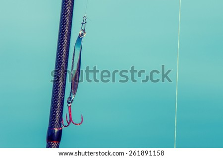 Carboxylic fishing rod with fishing line and lure. Vintage style - stock photo