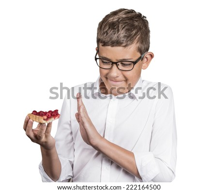 Carbs cravings. Portrait teenager boy craving cake confused funny looking man trying to withstand resist temptation to eat sweet tart isolated white background. Facial expression emotion reaction - stock photo