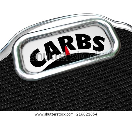 Carbs word on a scale to illustrate eating too much carbohydrates in your diet and needing to cut on snack food and lose weight - stock photo