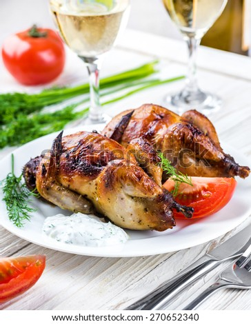 Carcasses of quail with tomatoes and wine. - stock photo