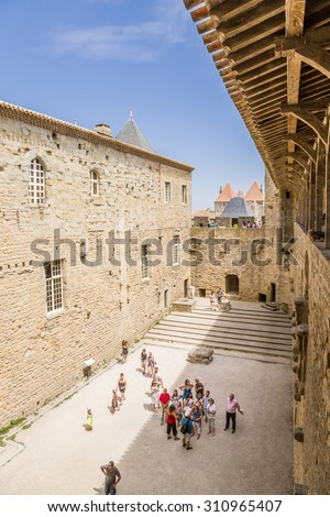 CARCASSONNE, FRANCE - JUL 19, 2015:  The courtyard of the castle Comtal in the fortress of Carcassonne, 1130
