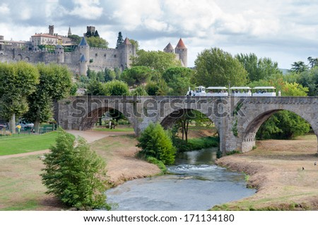 Carcassonne la cite medievale and train over pont vieux in France - stock photo