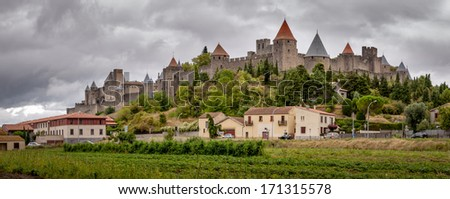 Carcassonne old fortified city panoramic view with stormy sky in France