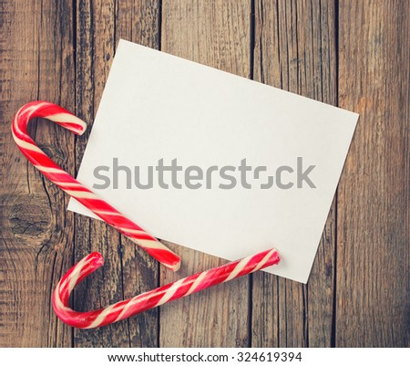 Card,candy.A letter for Christmas and New year.Toned image. Vintage style.Copy space. selective focus. - stock photo
