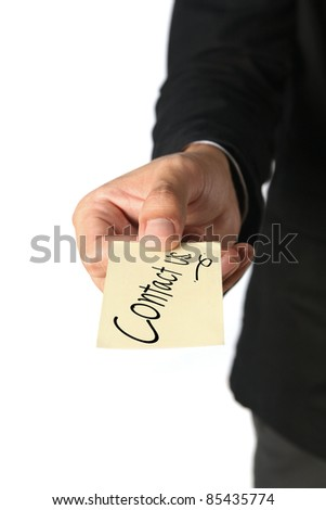 Card Contact us in hand  business man - stock photo