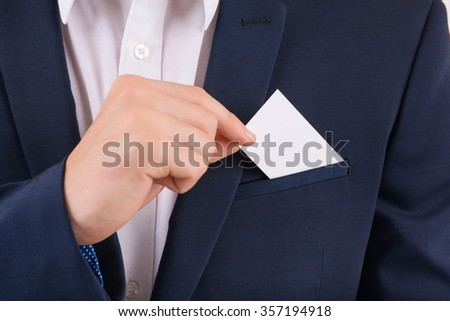 Card for advertising. Male hand taking out business card from breast pocket.  - stock photo