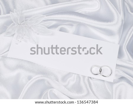 card for text and weddings accessories on white silk