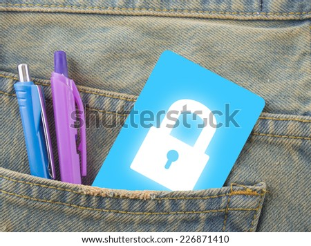 Card lock in a back pocket of a denim jeans as a background