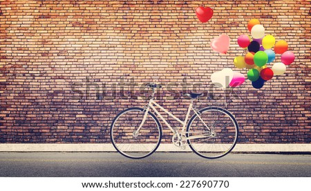 Card of bicycle vintage with heart balloon on road urban city concept of love in summer and wedding honeymoon - stock photo