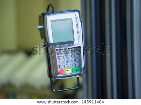 Card payment terminal on window at take out food restaurant - stock photo
