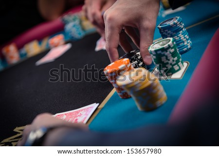 card player gambling casino chips on black felt background selective focus
