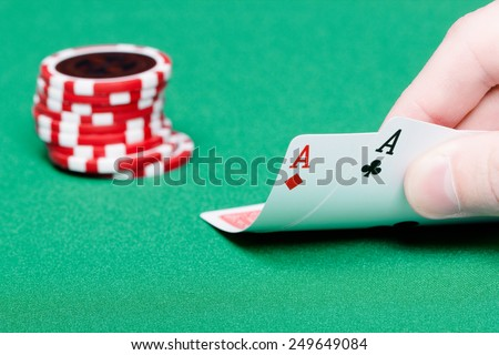 card player. Male hand with cards and chips close-up - stock photo