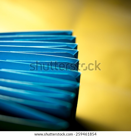 card stock in unique elliptical shapes with shadow effect and selective focus - stock photo