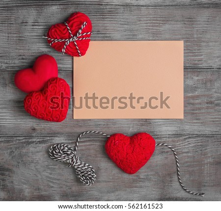 Card to Valentine's Day. Paper for text congratulations letter. Heart from red marzipan. Heart with pattern and heart sleek white wooden background. Top view