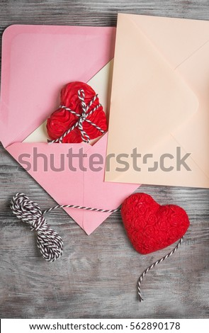 Card to Valentine's Day. Paper for text congratulations letter. Heart from red marzipan in box. Heart with pattern and heart sleek white wooden background. Top view. Flat lay.