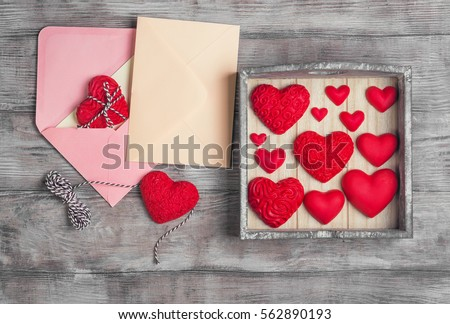 Card to Valentine's Day. Paper for text congratulations letter. Heart from red marzipan in box. Heart with pattern and heart sleek white wooden background. Top view. Flat lay