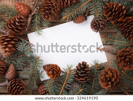Card with fir branch,pine cones .A letter for Christmas and New year.Copy space. selective focus. - stock photo