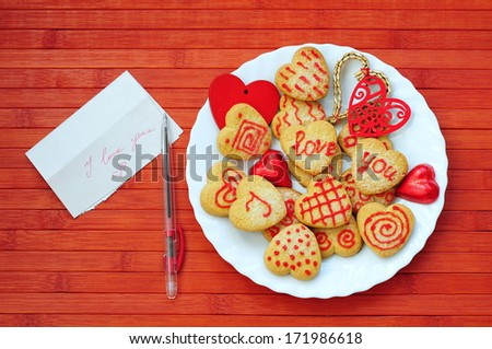 Card with Message Love You and Cookies in Shape of Heart at Valentine Day  - stock photo