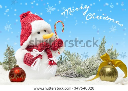card with Snowman  with candy cane in red hat and scarf  on blue background and falling snowflakes. Holiday concept for New Years with  inscription  - stock photo