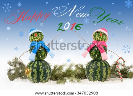 card with two watermelon Snowman  on blue background and falling snowflakes. Holiday concept for New Years with  inscription english and 2016 - stock photo