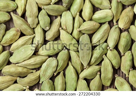 Cardamom green super food indian aroma spice close up background texture - stock photo