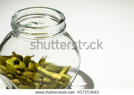 Cardamom pods in a glass jar
